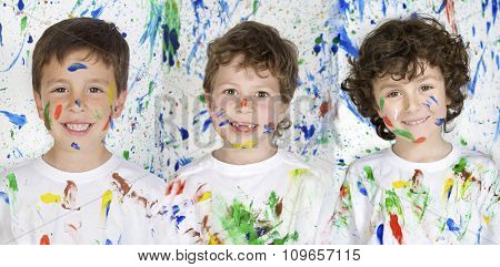 Three happy and painted children stained paint