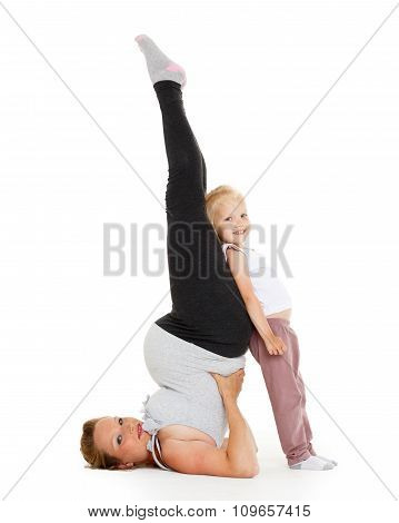 Pregnant Woman With Daugther. Fitness.