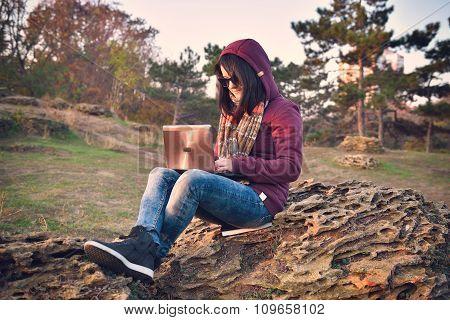 Hipster Girl Sitting On Rock