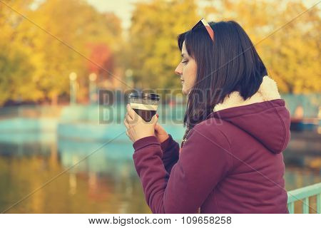 Girl Holding Coffee In Disposable Cup