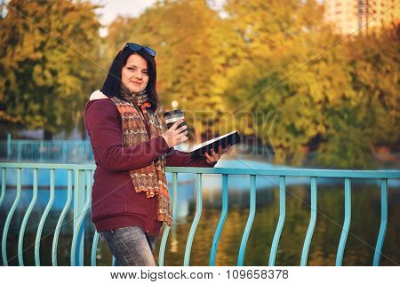 Girl With Cup Of Coffee And Book