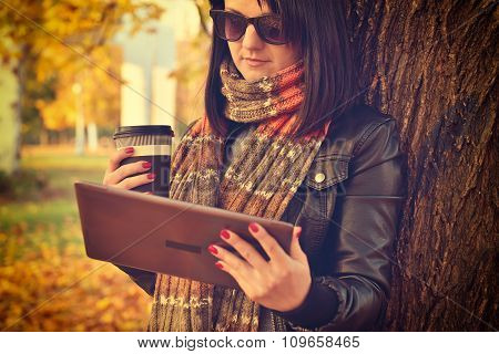 Girl With Coffee And Tablet