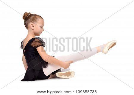 Ballerina Is Sitting On The Floor