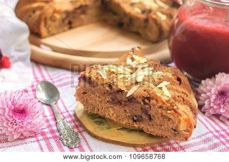 Piece Of Homemade Cake With Berry Sauce On Plate