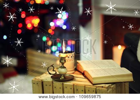 Composition with book, cup of hot drink on table, on colorful lights background