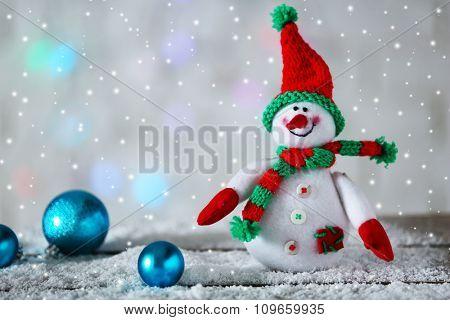 Cute snowman on Christmas background