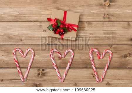 Christmas Background. Candy Canes, Heart Shape. Gift Box. Wooden
