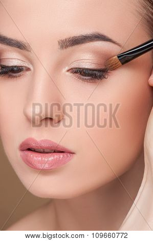 Attractive girl is receiving treatment at beauty salon