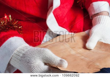 Santa Claus reeding a letter horizontal