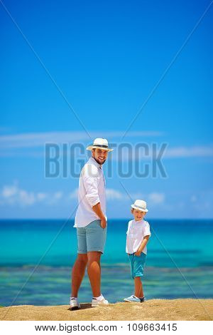 Smiling Father And Son On Summer Vacation Near The Seaside