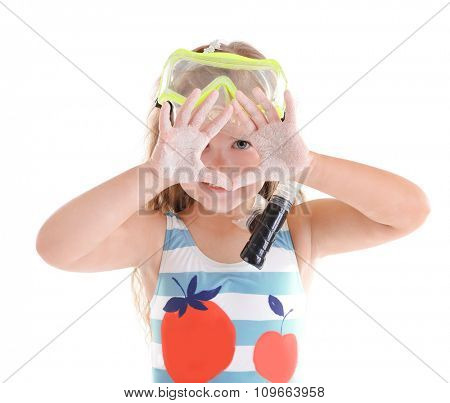 Happy little girl in blue striped swimsuit with diving mask poses on white background