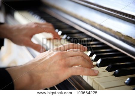 Close up of man hands classic piano playing
