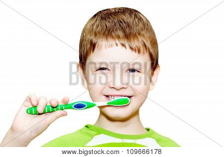 Portrait Of The Little Boy Brushing Her Teeth