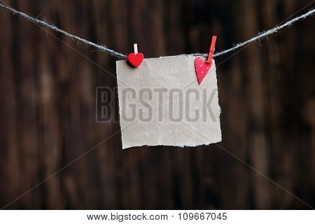 Blank paper note, on wooden background