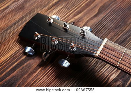 Guitar handle on wooden background