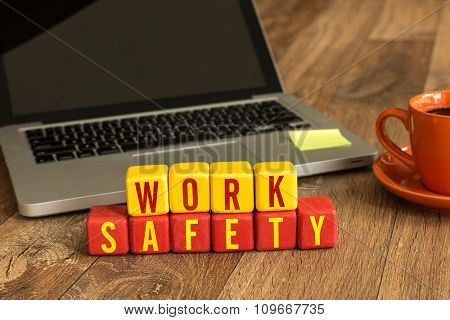 Work Safety written on a wooden cube in a office desk
