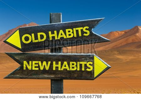 Old Habits - New Habits signpost in a desert background