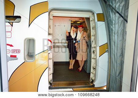 DUBAI - NOVEMBER 16, 2015: Emirates crew members on board of Boeing 777. Emirates is an airline based in Dubai, United Arab Emirates. It is the largest airline in the Middle East.