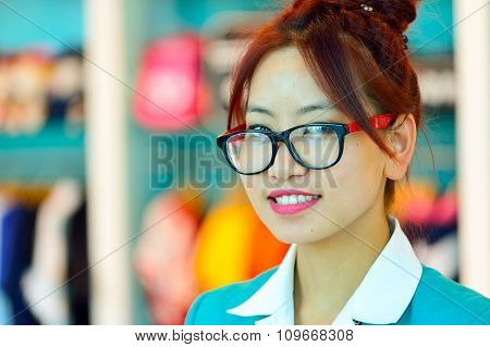 DUBAI, UAE - NOVEMBER 16, 2015: close up portrait of seller in Dubai Duty Free. Dubai Duty Free is the largest single airport retail operation in the world