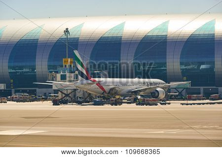 DUBAI, UAE - NOVEMBER 16, 2015: Boeing 777-300 docked in Dubai airport. Dubai International Airport is an international airport serving Dubai. It is a major airline hub in the Middle East