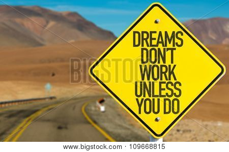 Dreams Don't Work Unless You Do sign on desert road