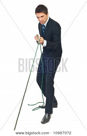 Businessman Trying Hard To Pulling Rope