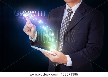 Businessman holding tablet with pressing growth. internet and networking concept