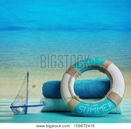 Summer accessories on sea background