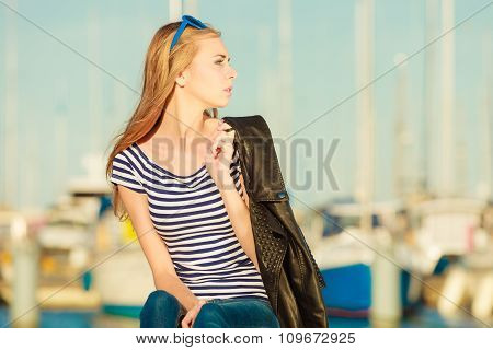 Woman In Marina Against Yachts In Port