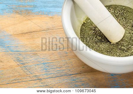 stevia dried leaves crushed in a mortar - natural sweetener, sugar substitute