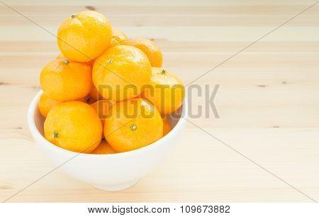 Mandarin Or China Orange In White Bowl On Wood Table