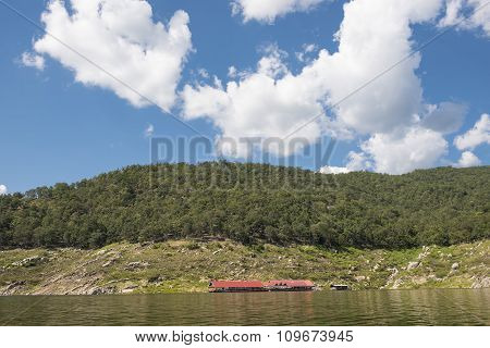 Floating house in the lake Bhumibol Dam Tak ,Thailand.
