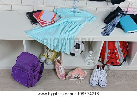 Children things stacked in room