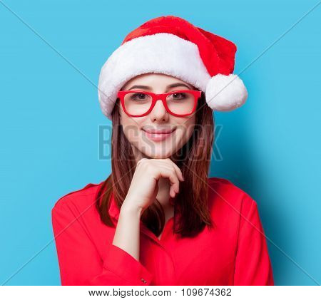 Woman In Santa Claus Hat And Glasses