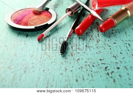 Make up set on wooden table, closeup