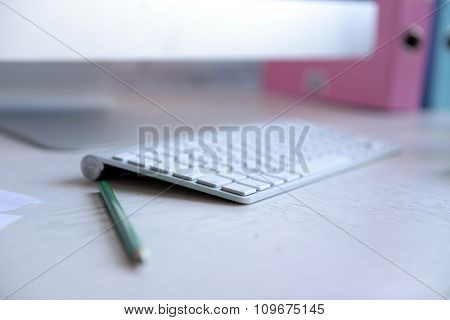 Wireless keyboard and mouse on the table, close up