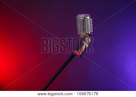 Retro microphone against colourful background