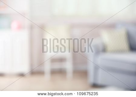 Blurred home interior with Gray sofa
