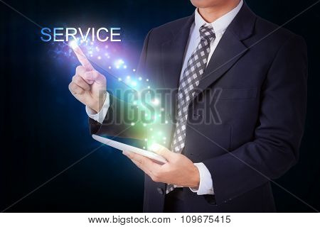 Businessman holding tablet with pressing service. internet and networking concept