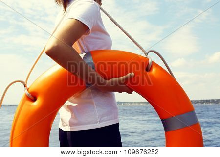 Girl with a life buoy