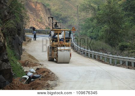 Rollers machines working on an under-construction mountain road
