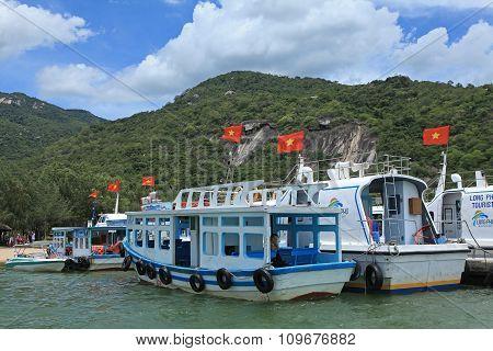Passenger boats casting anchor at a harbor in Nha Trang beach city