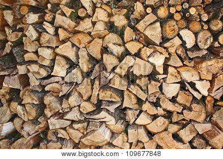 Stack of apple wood cut from garden
