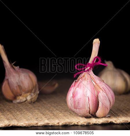 Garlic Bulb On The Dark Background