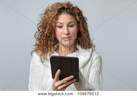 Woman Reading A Message On Her Tablet