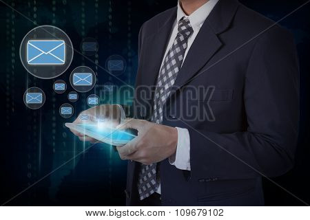 Businessman hand touch screen e-mail sign icons on a tablet.