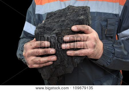 Coal in the hands of a miner. close-up