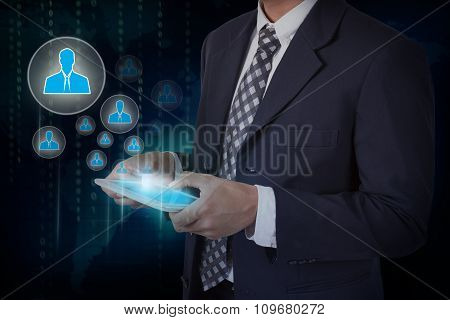 Businessman hand touch screen people icons on a tablet. internet and technology concept.