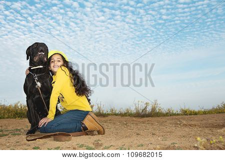 Little Girl Playing With Her Pet Dog