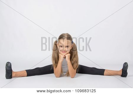 Girl Gymnast Performs A Cross Twine